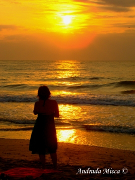 Woman on the beach at sunrise no 1